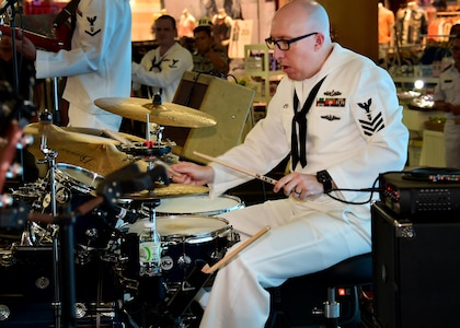 170604-N-QV906-051 PATTAYA, Thailand (June 4, 2017) Navy Musician 1st Class Stephen Hux, of the U.S. 7th Fleet Band, Orient Express, jams out during a performance at Golden Plaza Mall in Pattaya, Thailand, while participating in Cooperation Afloat Readiness and Training Thailand 2017 June 3.  Cooperation Afloat Readiness and Training (CARAT) is a series of PACOM sponsored, U.S. Pacific Fleet led bilateral exercises held annually in South and Southeast Asia to strengthen relationships and enhance force readiness. CARAT exercise events cover a broad range of naval skill areas and disciplines including surface, undersea, air and amphibious warfare; maritime security operations; riverine, jungle and explosive ordnance disposal operations; combat construction; diving and salvage; search and rescue; maritime patrol and reconnaissance aviation; maritime domain awareness; military law, public affairs and military medicine; and humanitarian assistance, disaster response. (U.S. Navy photo by Mass Communication Specialist 1st Class Micah Blechner/RELEASED)
