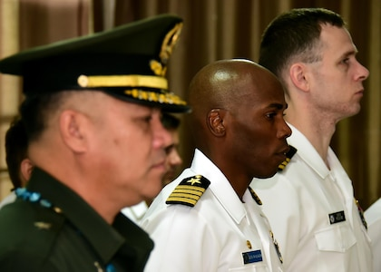 170619-N-QV906-016 CEBU, Philippines (June 19, 2017) Commodore, Destroyer Squadron 7 Capt. Lex Walker (center) stands during the inaugural opening ceremony for Maritime Training Activity (MTA) Sama Sama 2017 at Naval Forces Central in Cebu, Philippines, June 16.  MTA Sama Sama is a bilateral maritime exercise between U.S. and Philippine naval forces and is designed to strengthen cooperation and interoperabillty between the nations' armed forces.  (U.S. Navy photo by Mass Communication Specialist 1st Class Micah Blechner/RELEASED)