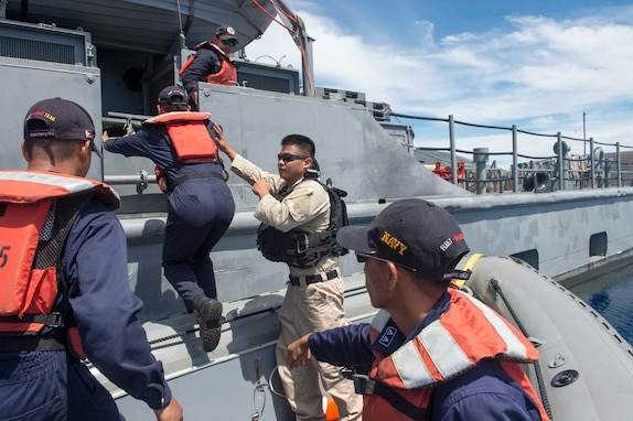 170623-N-PD309-168 BOHOL SEA (June 23, 2017) Engineman 2nd Class Reynaldo Saura, assigned to littoral combat ship USS Coronado (LCS 4), works with members of the Philippine Navy during a visit, board, search and seizure exercise for Maritime Training Activity (MTA) Sama Sama 2017. MTA Sama Sama is a bilateral maritime exercise between U.S. and Philippine naval forces and is designed to strengthen cooperation and interoperability between the nations' armed forces.   (U.S. Navy photo by Mass Communication Specialist 3rd Class Deven Leigh Ellis/Released)