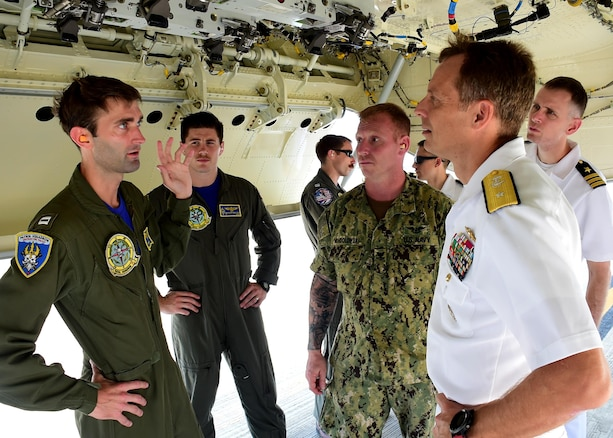 170623-N-QV906-126 CEBU, Philippines (June 23, 2017) Lt. Carson Burton (left), and Lt. Mason Bailey, and Aviation Ordnanceman 2nd Class Joseph Wondolowski, of Combat Air Crew 4 attached to Patrol Squadron 26 (VP-26), discuss the capabilities of a P-8 Poseidon aircraft inside its weapons bay during Maritime Training Activity (MTA) Sama Sama in Cebu, Philippines, June 23.  MTA Sama Sama is a bilateral maritime exercise between U.S. and Philippine naval forces and is designed to strengthen cooperation and interoperability between the nations' armed forces.  (U.S. Navy photo by Mass Communication Specialist 1st Class Micah Blechner/RELEASED)