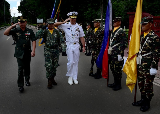 170623-N-QV906-224 CAMP LAPU-LAPU, Philippines (June 23, 2017) Rear Adm. Don Gabrielson (middle), Commander, Logistics Group Western Pacific, and Maj. Gen. Oscar Lactao (left), Commander, Armed Forces of the Philippines Central Command, perform a Command Review during Maritime Training Activity (MTA) Sama Sama 2017 at Camp Lapu-Lapu, Philippines, June 23.  MTA Sama Sama is a bilateral maritime exercise between U.S. and Philippine naval forces and is designed to strengthen cooperation and interoperability between the nations' armed forces.  (U.S. Navy photo by Mass Communication Specialist 1st Class Micah Blechner/RELEASED)