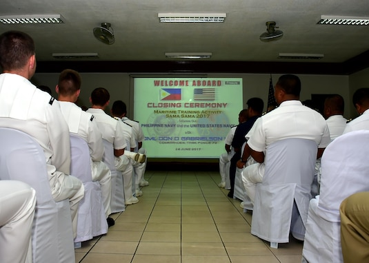 170624-N-QV906-047 CEBU, Philippines (June 24, 2017) Servicemembers from the U.S. Navy and the Armed Forces of the Philippines conduct the closing ceremony for Maritime Training Activity (MTA) Sama Sama 2017 in Cebu, Philippines, June 24.  MTA Sama Sama is a bilateral maritime exercise between U.S. and Philippine naval forces and is designed to strengthen cooperation and interoperability between the nations' armed forces.  (U.S. Navy photo by Mass Communication Specialist 1st Class Micah Blechner/RELEASED)