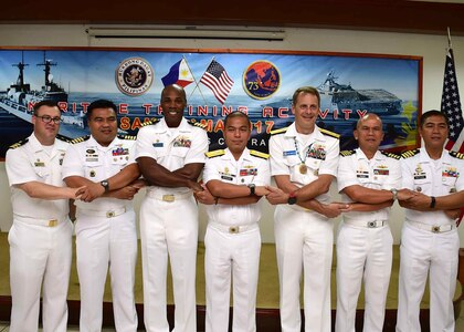170624-N-QV906-164 CEBU, Philippines (June 24, 2016) Officers from the U.S. Navy and Armed Forces of the Philippines stand hand-in-hand during the closing ceremony of Maritime Training Activity (MTA) Sama Sama 2017 in Cebu, Philippines, June 24. (U.S. Navy photo by Mass Communication Specialist 1st Class Micah Blechner/RELEASED)