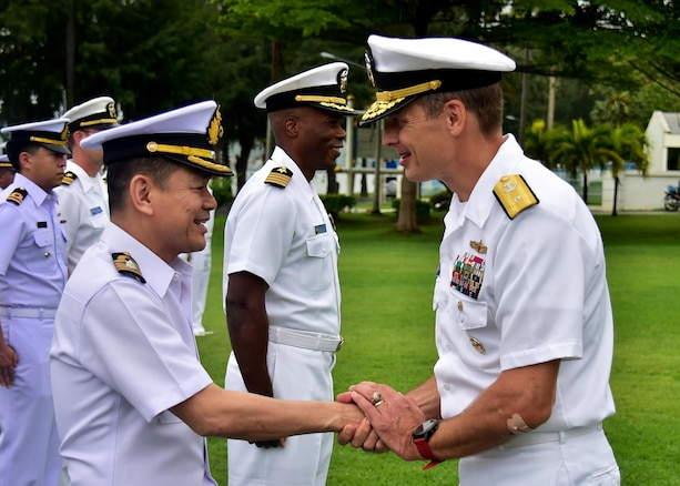 170529-N-QV906-107 SATTAHIP NAVAL BASE, Thailand (May 29, 2017) - Rear Adm. Don Gabrielson, Commander, Task Force 73, greets Rear Adm. Chaiyanun Nuntawit, Commander, Frigate Squadron II, at the opening ceremony of Cooperation Afloat Readiness and Training Thailand 2017 on Sattahip Naval Base May, Thailand, 29.  Commander, Cooperation Afloat Readiness and Training (CARAT) is a series of PACOM sponsored, U.S. Pacific Fleet led bilateral exercises held annually in South and Southeast Asia to strengthen relationships and enhance force readiness. CARAT exercise events cover a broad range of naval skill areas and disciplines including surface, undersea, air and amphibious warfare; maritime security operations; riverine, jungle and explosive ordnance disposal operations; combat construction; diving and salvage; search and rescue; maritime patrol and reconnaissance aviation; maritime domain awareness; military law, public affairs and military medicine; and humanitarian assistance, disaster response. (U.S. Navy photo by Mass Communication Specialist 1st Class Micah Blechner/RELEASED)