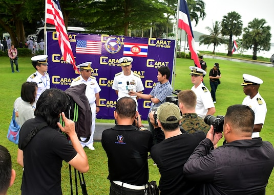 170529-N-QV906-137 SATTAHIP NAVAL BASE, Thailand (May 29, 2017) - Rear Adm. Don Gabrielson, Commander, Task Force 73, and Rear Adm. Somnuk Preampramot, Deputy Chief of Staff, Royal Thai Fleet, participate in a media availability after the opening ceremony for Cooperation Afloat Readiness and Training Thailand 2017 on Sattahip Naval Base, Thailand, May 29.  Cooperation Afloat Readiness and Training (CARAT) is a series of PACOM sponsored, U.S. Pacific Fleet led bilateral exercises held annually in South and Southeast Asia to strengthen relationships and enhance force readiness. CARAT exercise events cover a broad range of naval skill areas and disciplines including surface, undersea, air and amphibious warfare; maritime security operations; riverine, jungle and explosive ordnance disposal operations; combat construction; diving and salvage; search and rescue; maritime patrol and reconnaissance aviation; maritime domain awareness; military law, public affairs and military medicine; and humanitarian assistance, disaster response. (U.S. Navy photo by Mass Communication Specialist 1st Class Micah Blechner/RELEASED)