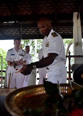170529-N-QV906-195 SATTAHIP NAVAL BASE, Thailand (May 29, 2017) - Deputy Commander, Destroyer Squadron 7, Capt. Alexis Walker lights incence at a Buddist Temple on Sattahip Naval Base after the openinc ceremony for Cooperation Afloat Readiness and Training Thailand 2017 May 29.  Cooperation Afloat Readiness and Training (CARAT) is a series of PACOM sponsored, U.S. Pacific Fleet led bilateral exercises held annually in South and Southeast Asia to strengthen relationships and enhance force readiness. CARAT exercise events cover a broad range of naval skill areas and disciplines including surface, undersea, air and amphibious warfare; maritime security operations; riverine, jungle and explosive ordnance disposal operations; combat construction; diving and salvage; search and rescue; maritime patrol and reconnaissance aviation; maritime domain awareness; military law, public affairs and military medicine; and humanitarian assistance, disaster response. (U.S. Navy photo by Mass Communication Specialist 1st Class Micah Blechner/RELEASED)