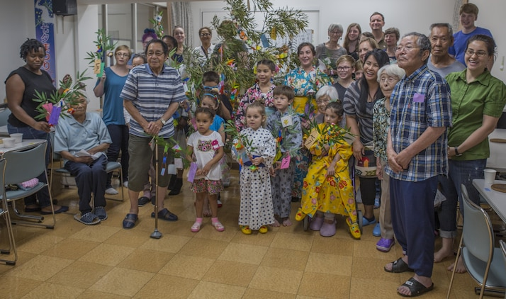 Marine Corps Air Station Iwakuni residents pose for a group photo with Japanese locals during a visit to Kinjuen Nursing Home with the MCAS Iwakuni Cultural Adaptation Program at Iwakuni City, Japan, July 7, 2017. The nursing home invited Americans from the air station to celebrate Tanabata, also known as the star festival. Participants in the event enjoyed traditional foods and other activities, like somen nagashi, or sliding somen noodles, and tying their wish to a bamboo branch. (U.S. Marine Corps photo by Lance Cpl. Gabriela Garcia-Herrera)