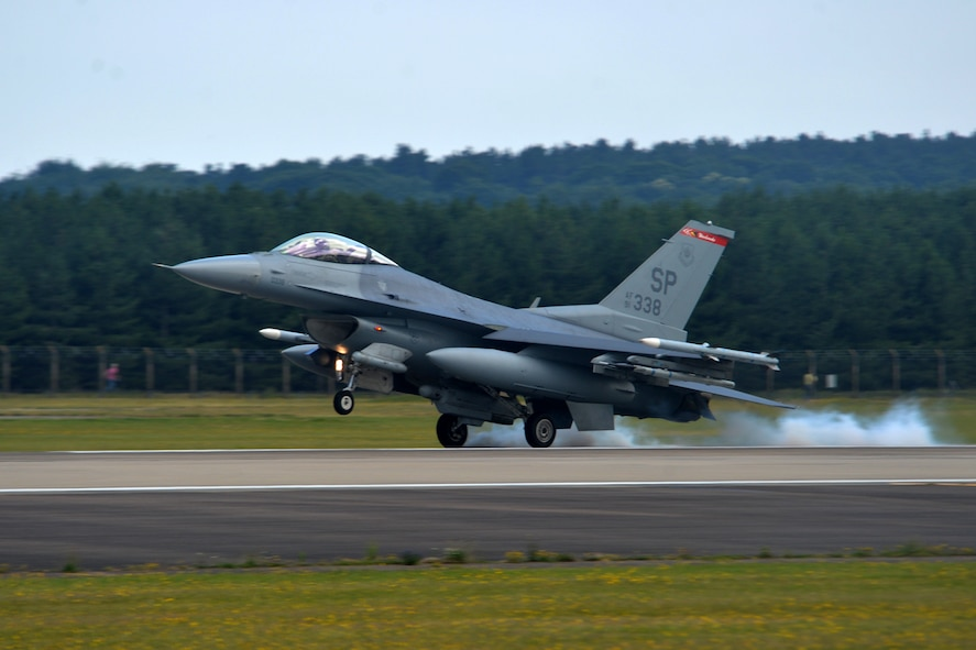 An F-16 Fighting Falcon assigned to the 52nd Fighter Wing at Spangdahlem Air Base, Germany, lands at Royal Air Force Lakenheath, England, July 10. Airmen from the 52nd FW will train alongside 48th Fighter Wing Airmen and British Allies during a flying training deployment here, which is scheduled to last several weeks. (U.S. Air Force photo/Master Sgt. Eric Burks)