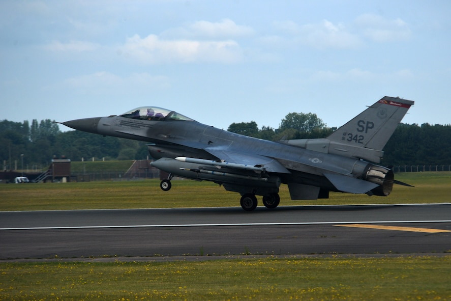 An F-16 Fighting Falcon from the 52nd Fighter Wing at Spangdahlem Air Base, Germany, lands at Royal Air Force Lakenheath, England, July 10. More than 260 Airmen and 18 F-16 Fighting Falcon aircraft from the 52nd FS will be participating in a flying training deployment here. (U.S. Air Force photo/Master Sgt. Eric Burks)