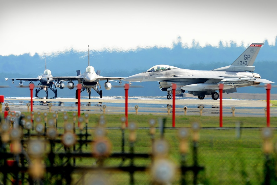 F-16 Fighting Falcon aircraft from the 480th Fighter Squadron, Spangdahlem Air Base, Germany, arrive at Royal Air Force Lakenheath, England, July 10. Airmen from the 52nd FW will train alongside 48th Fighter Wing Airmen and British Allies during a flying training deployment here, which is scheduled to last several weeks. (U.S. Air Force photo/Tech. Sgt. Matthew Plew)