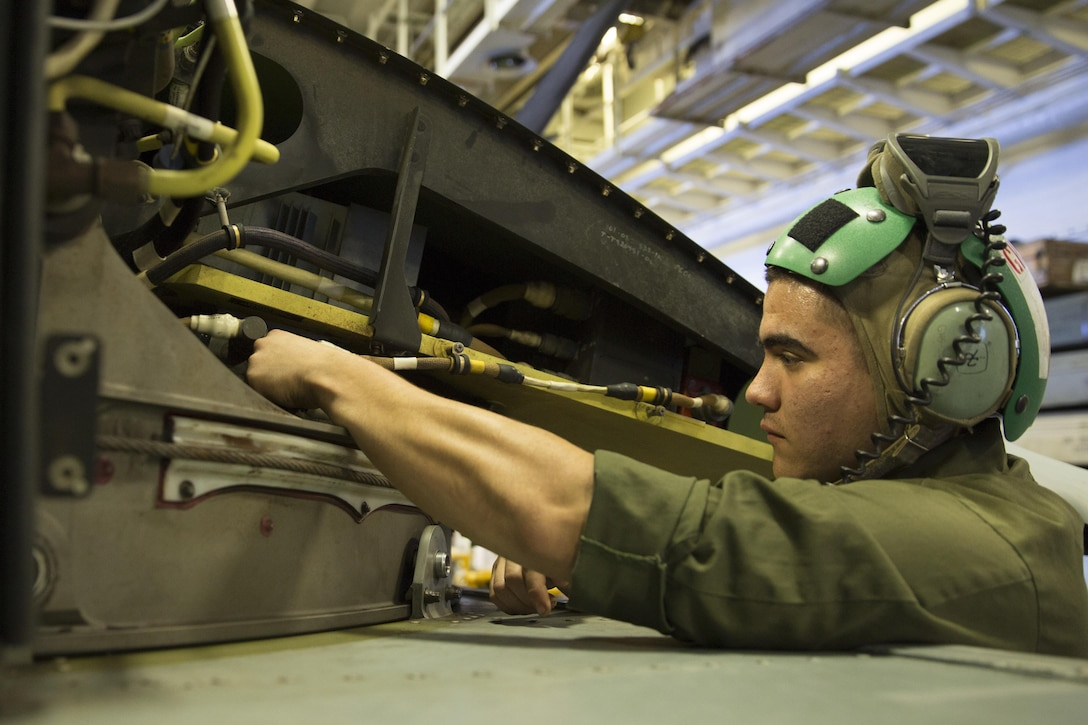 Cpl. Robert Lozano, an avionics technician attached to Marine Medium Tiltrotor Squadron 265 conducts maintenance on an MV-22B Osprey, in the hangar bay of the USS Bonhomme Richard while underway in the Pacific Ocean, July 8, 2017. A Harlingen, Texas native, Lozano enlisted in the Marine Corps in February 2014 at 19, after graduating from Los Fresnos High School. VMM-265 is part of the Aviation Combat Element of the 31st Marine Expeditionary Unit, currently supporting Talisman Saber 17 while deployed on its regularly-scheduled patrol of the Indo-Asia-Pacific region. Talisman Sabre is a biennial exercise designed to improve the interoperability between Australian and U.S. forces.
