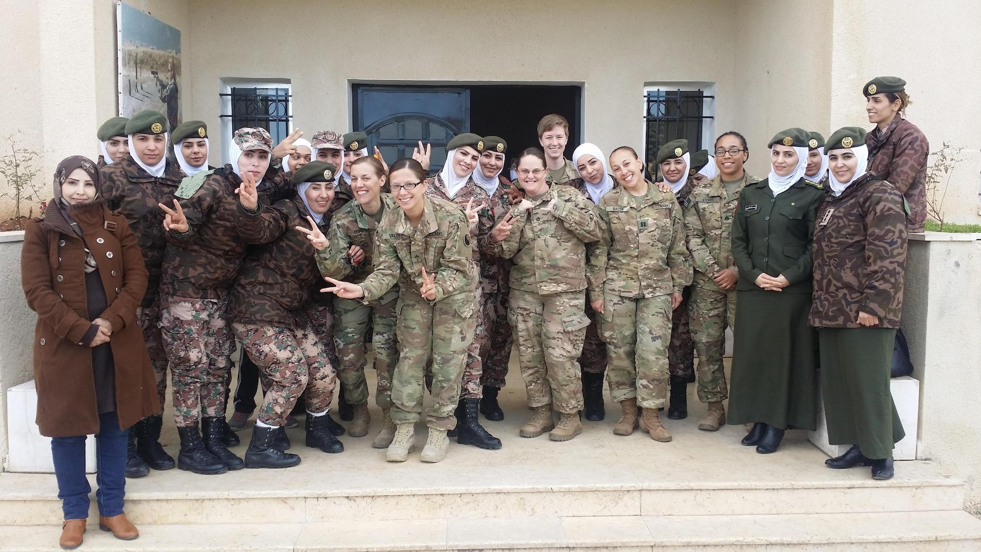 Female Maryland and Virginia National Guard Soldiers from the 29th Infantry Division pose with female soldiers from the Jordan Armed Forces- Arab Army Female Company For Special Security Tasks during an engagement Jan. 17, 2017, near Amman, Jordan. While in Jordan from September 2016- July 2017, Soldiers of Task Force 29 planned and coordinated multiple engagements with JAF female soldiers, providing both U.S. and Jordanian military women the opportunity to exchange information and best practices on leadership, communications skills and various women's empowerment topics. (Courtesy photo)