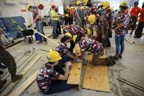From June 17 to June 21, 2017 high school students from the Society of American Military Engineer (SAME) participate in engineer themed events at Courthouse Bay, Camp Lejeune, N.C. Students measure, cut, and assemble pieces of wood to construct a concrete beam form.