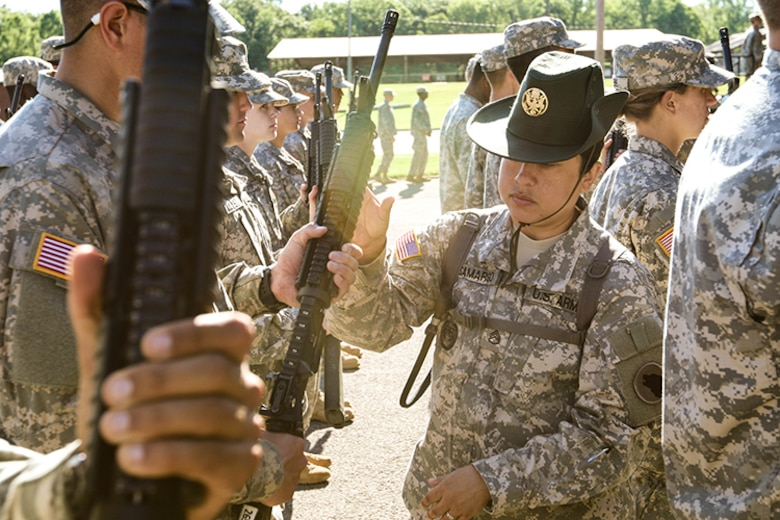 U.S. Army Reserve Staff Sgt. Jennifer Samargo, a drill sergeant with the 104th Training Division based at Joint Base Fort Lewis McChord in Washington State and assigned to Task Force Wolf, corrects the position of a Reserve Officers' Training Corps cadet attending Cadet Summer Training (CST) at Fort Knox, Kentucky, June 7, 2017. Every drill sergeant assigned to Task Force Wolf is an Army Reserve Soldier.  (U.S. Army photo by Army Staff Sgt. Scott Griffin, U.S. Army Reserve Command-Public Affairs Office) (RELEASED)