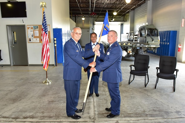 Lt. Col. Paul E. Cannon hands the Mission Support Group guidon to incoming 30th Aerial Port Squadron commander, Capt. Douglas B. Buffone, at an official change of command ceremony at the 914th Air Refueling Wing, July 8, 2017, NIAGARA FALLS, N.Y. Buffone has been interim commander since January of this year. (U.S. Air Force photograph by Staff Sgt. Richard Mekkri)