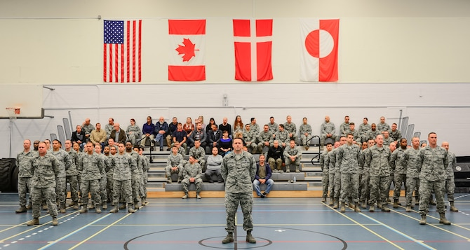 Airmen from the 821st Air Base Group stand in formation and attend the 821st ABG change of command, June 29, 2017, at Thule Air Base, Greenland. The 821st ABG operates and maintains the air base in support of missile warning, space surveillance, and satellite command and control operations and missions. (U.S. Air Force photo by Capt. Md Hussain)