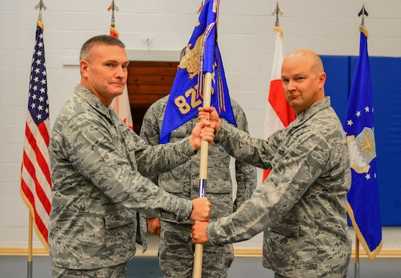 THULE AIR BASE, Greenland – Col. Eric Dorminey, 21st Space Wing vice commander, passes the guidon to Col. Thomas Colvin, 821st Air Base Group commander, during the 821st Air Base Group change of command ceremony, June 29, 2017, at Thule Air Base, Greenland. The group operates and maintains the air base in support of missile warning, space surveillance, satellite command and control operations missions. The group provides security, communications, civil engineering, personnel, services, logistics and medical support to remote active duty units in a combined U.S., Canadian, Danish and Greenlandic environment of approximately 550 military, civilian and contractor personnel. (U.S. Air Force photo by Capt. Md Hussain)