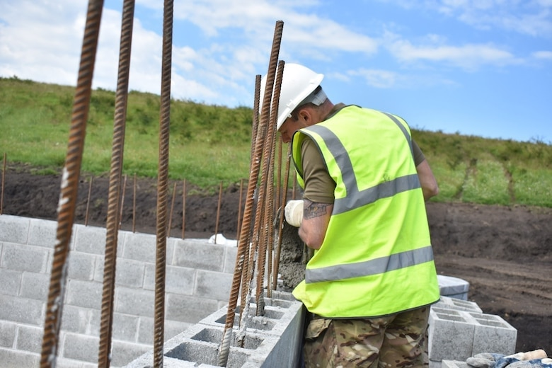 A Soldier of the U.K. Royal Monmouthshire Royal Engineers pours grout for a Light Demolition Range as part of Operation Resolute Castle 2017 at the Joint National Training Center, Cincu, Romania. Resolute Castle is an exercise strengthening the NATO alliance and enhancing its capacity for joint training and response to threats within the region.