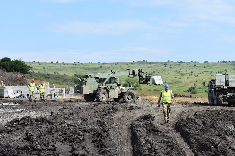 A Skytrak lifts construction materials for a Light Demolition Range in a joint effort by the 926th Engineer Brigade and the U.K. Royal Monmouthshire Royal Engineers (Militia). The construction project is a part of Operation Resolute Castle 2017 at the Joint National Training Center, Cincu, Romania. Resolute Castle is an exercise strengthening the NATO alliance and enhancing its capacity for joint training and response to threats within the region.