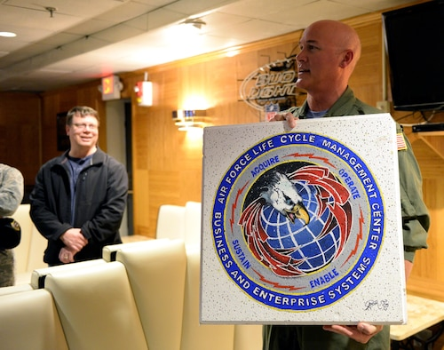 Col. Barry Dickey, Air University director of staff, holds up a decorated ceiling tile at the Maxwell Club, May 5, 2017. The Maxwell Club is changing its focus to create a comfortable environment for Airmen of all ranks to enjoy The Pit. (U.S. Air Force photo/Senior Airman Tammie Ramsouer)
