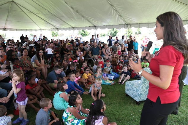 Alexa Garcia, an Ambassador with The Walt Disney Company, addresses the crowd prior to a book reading, Camp Pendleton, Calif., July 8th, 2017. Books on Bases brings books to military children and is a part of Blue Star Families' and The Walt Disney Company's  ongoing effort to to support military families across the nation. (U.S. Marine Corps Photo by LCpl. Dylan Chagnon)
