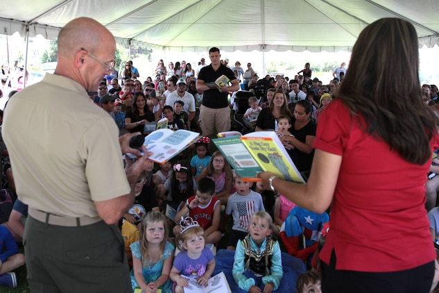 "Col. Gary S. Johnston, Chief of Staff, Marine Corps Installations - West, along with Alexa Garica, Disney Ambassador, and a volunteer from the crowd read aloud ""The Big Guy Took My Ball"" to children and their families during Books on Bases, Camp Pendleton, Calif., July 8th, 2017. Books on Bases brings books to military children and is a part of Blue Star Families' and The Walt Disney Company's  ongoing effort to to support military families across the nation. (U.S. Marine Corps Photo by LCpl. Dylan Chagnon)"