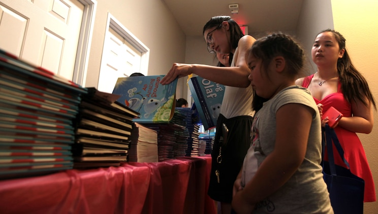 A mother helps her daughter choose a book during Books on Bases, Camp Pendleton, Calif., July 8th, 2017. Books on Bases brings books to military children and is a part of Blue Star Families' and The Walt Disney Company's  ongoing effort to to support military families across the nation. (U.S. Marine Corps Photo by LCpl. Dylan Chagnon)