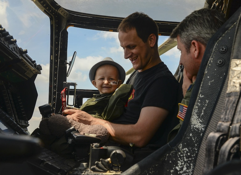 Jay Davidson and his father, Martin, sit in a U.S. Air Force CV-22 Osprey during a Pilot for a Day visit July 7, 2017, on RAF Mildenhall, England. During the visit, Jay and his parents also viewed a KC-135 Stratotanker and an MC-130J Commando II, in addition to a tour of the air traffic control tower. (U.S. Air Force photo by Staff Sgt. Micaiah Anthony)
