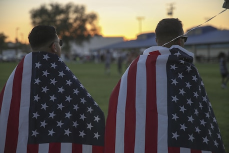 Two Marine Corps Air Ground Combat Center Marines display their patriotism by adorning the national colors