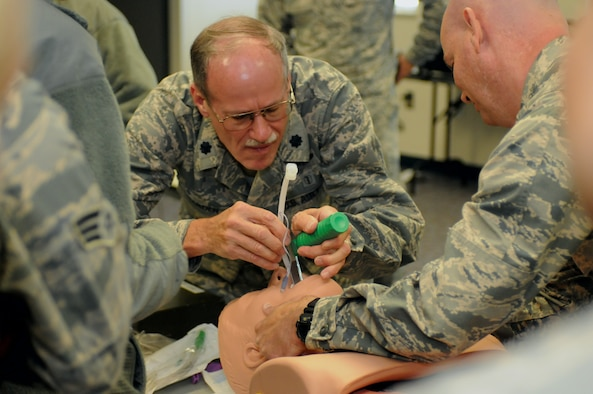 Lt. Col. Glen Hardin, a flight surgeon with the Iowa Air National Guard's 185th Air Refueling Wing, demonstrates intubation in which a tube is inserted in a patient to help keep their airway open. The training was part of training the unit's medical group conducted while at Camp Rilea, Oregon. The Airmen were in Oregon to participate in Pathfinder-Minuteman, a mass causality exercise. U.S. Air National Guard photo by Capt. Jeremy J. McClure