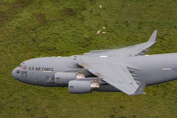 "Citizen Airmen from the 701st Airlift Squadron made history by flying the first C-17 Globemaster III low-level pass through the ""Mach Loop"" in Wales, U.K. (Courtesy Photo by Paul Williams)"