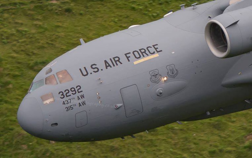"""Citizen Airmen from the 701st Airlift Squadron made history by flying the first C-17 Globemaster III low-level pass through the """"Mach Loop"""" in Wales, U.K. (Courtesy Photo by Paul Williams)"""