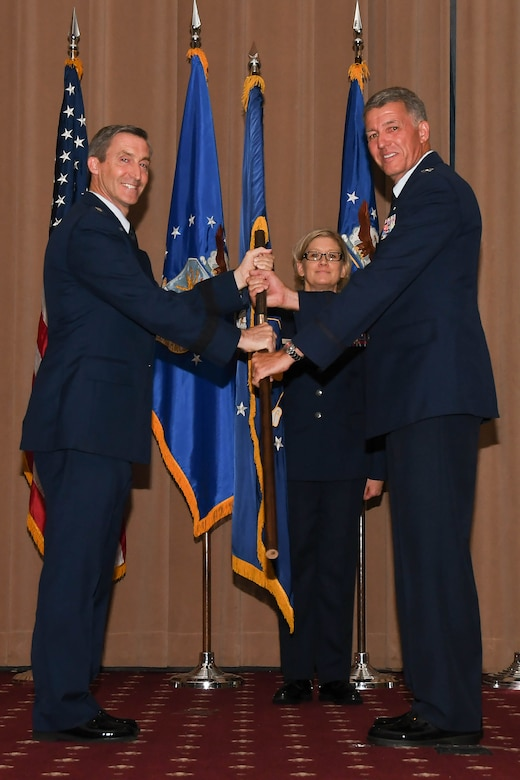 U.S. Air Force Maj. Gen. Bruce Miller, 10th Air Force commander, passes the wing guidon to Colonel Robert VanHoy II during the 307th Bomb Wing change of command ceremony July 8, 2017 at Barksdale Air Force Base, La.  As the flag is exchanged, the authority and responsibility for the 307th Bomb Wing mission and its personnel is transferred. VanHoy was formerly the commander for the 93rd Bomb Squadron and has several years of experience within the wing. (U.S. Air Force photo by Staff Sgt. Callie Ware/Released)