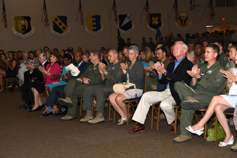 Distinguished guests and visitors applaud Colonel Robert VanHoy II as he assumes command of the 307th Bomb Wing July 8, 2017 at Barksdale Air Force Base, La. VanHoy was formally the commander for the 93rd Bomb Squadron and has several years of experience within the wing. (U.S. Air Force photo by Staff Sgt. Callie Ware/Released)
