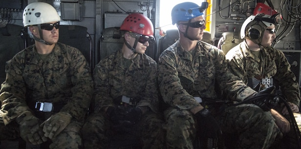 Four expeditionary operations training group instructors prepare to rappel from a CH-53 Super Stallion during a ceremony at Stone Bay, a Camp Lejeune satellite training area, N.C., May 17, 2017.  The ceremony marks the reopening of Landing Zone Vulture, which closed Sept. 2, 2015 after a CH-53 crashed resulting in the death of one Marine.  The instructors took the opportunity to memorialize their fallen Marine, Staff Sgt. Jonathan Lewis, through the sustainment rappel. The Marines are with EOTG, II Marine Expeditionary Force Headquarters Group.