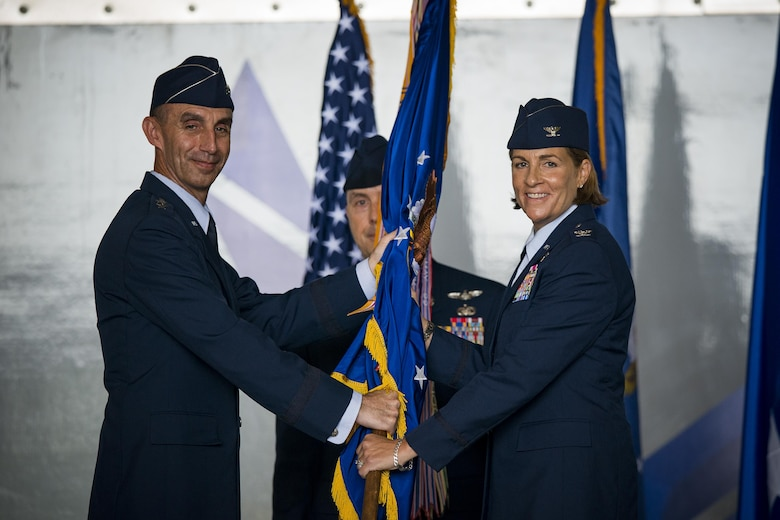 U.S. Air Force Maj. Gen. Scott J. Zobrist (left), 9th Air Force commander, hands the 23d Wing guideon to Col. Jennifer Short, 23d Wing commander, during a change of command ceremony, July 10, 2017, at Moody Air Force Base, Ga. Short is a senior pilot with more than 1,800 hours flying A-10 and trainer aircraft, and before becoming a pilot, served as a C-130 Navigator. (U.S. Air Force photo by Staff Sgt. Ryan Callaghan)