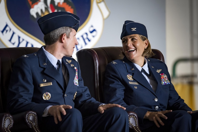 Col. Jennifer Short, right, 23d Wing commander, shares a laugh with Col. Thomas Kunkel, outgoing 23d Wing commander, during a change of command ceremony, July 10, 2017, at Moody Air Force Base, Ga. Short is a senior pilot with more than 1,800 hours flying A-10 and trainer aircraft, and before becoming a pilot, she served as a C-130E Hercules Navigator. (U.S. Air Force photo by Staff Sgt. Ryan Callaghan)