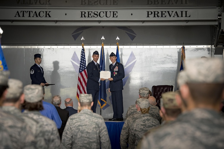 U.S. Air Force Maj. Gen. Scott J. Zobrist (left), 9th Air Force commander, presents the Legion of Merit award to Col. Thomas Kunkel, outgoing 23d Wing commander, during a change of command ceremony, July 10, 2017, at Moody Air Force Base, Ga. After giving up command of the 23d Wing, Kunkel will continue his career by serving as a Legislative Liaison at the Pentagon, Washington, D.C. (U.S. Air Force photo by Staff Sgt. Ryan Callaghan)