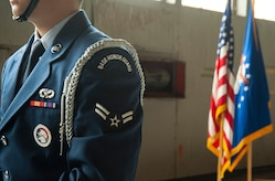 A Joint Base Andrews Base Honor Guard member stands in formation before the 811th Operations Group change of command ceremony at Joint Base Andrews, Md., July 7, 2017. Col. Scott A. Grundahl relieved Col. Fred C. Koegler III as commander of the 811th OG. The group consists of the 811th Operations Support Squadron and the 1st Helicopter Squadron both of which provide the National Capital Region with continuous rotary-wing contingency response. (U.S. Air Force photo by Christopher Hurd)