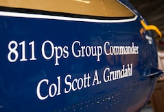 The 811th Operations Group unveiled incoming commander Col. Scott A. Grundahl's name on a UH-1N Iroquois helicopter during the group's change of command ceremony at Joint Base Andrews, Md., July 7, 2017. The group consists of the 811th Operations Support Squadron and the 1st Helicopter Squadron both of which provide the National Capital Region with continuous rotary-wing contingency response. (U.S. Air Force photo by Christopher Hurd)