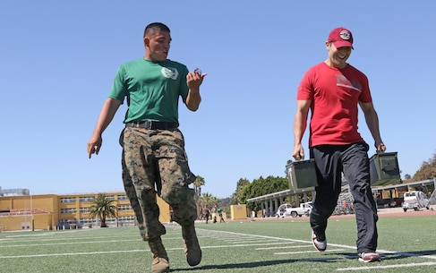 Marine Corps Sgt. Kelvin Gonzalez calls out Vitali Andreev's time during a combat fitness test at Marine Corps Recruit Depot San Diego, June 13, 2017. Andreev is a teacher for Rosary Academy in Fullerton, Calif., and attended this year's Educators Workshop to get a once in a lifetime, candid look into the U.S. Marine Corps. This all-expense paid workshop immerses teachers, coaches, counselors, principals and band directors into the unknowns of the organization so they may broaden their perspective and pass their experience and knowledge onto their students.