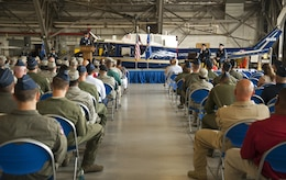 Audience members look on as Col. E. John Teichert, 11th Wing and Joint Base Andrews commander, gives his opening remarks during the 811th Operations Group change of command ceremony at Joint Base Andrews, Md., July 7, 2017. Col. Scott A. Grundahl relieved Col. Fred C. Koegler III as commander of the 811th OG. The group consists of the 811th Operations Support Squadron and the 1st Helicopter Squadron both of which provide the National Capital Region with continuous rotary-wing contingency response. (U.S. Air Force photo by Christopher Hurd)