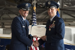 Col. E. John Teichert, 11th Wing and Joint Base Andrews commander, left, presents outgoing 811th Operations Group Commander Col. Fred C. Koegler III with the Legion of Merit award during the 811th OG change of command ceremony at Joint Base Andrews, Md., July 7, 2017. Koegler was presented the award for his exceptional meritorious conduct as commander. The group consists of the 811th Operations Support Squadron and the 1st Helicopter Squadron both of which provide the National Capital Region with continuous rotary-wing contingency response. (U.S. Air Force photo by Christopher Hurd)