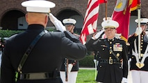 U.S. Marine Corps Lt. Gen. Jon M. Davis, deputy commandant, Aviation, salutes the flag during the playing of the national anthem during his retirement ceremony at Marine Barracks Washington, Washington, D.C., July 10, 2017. Davis retired after 37 years of service.