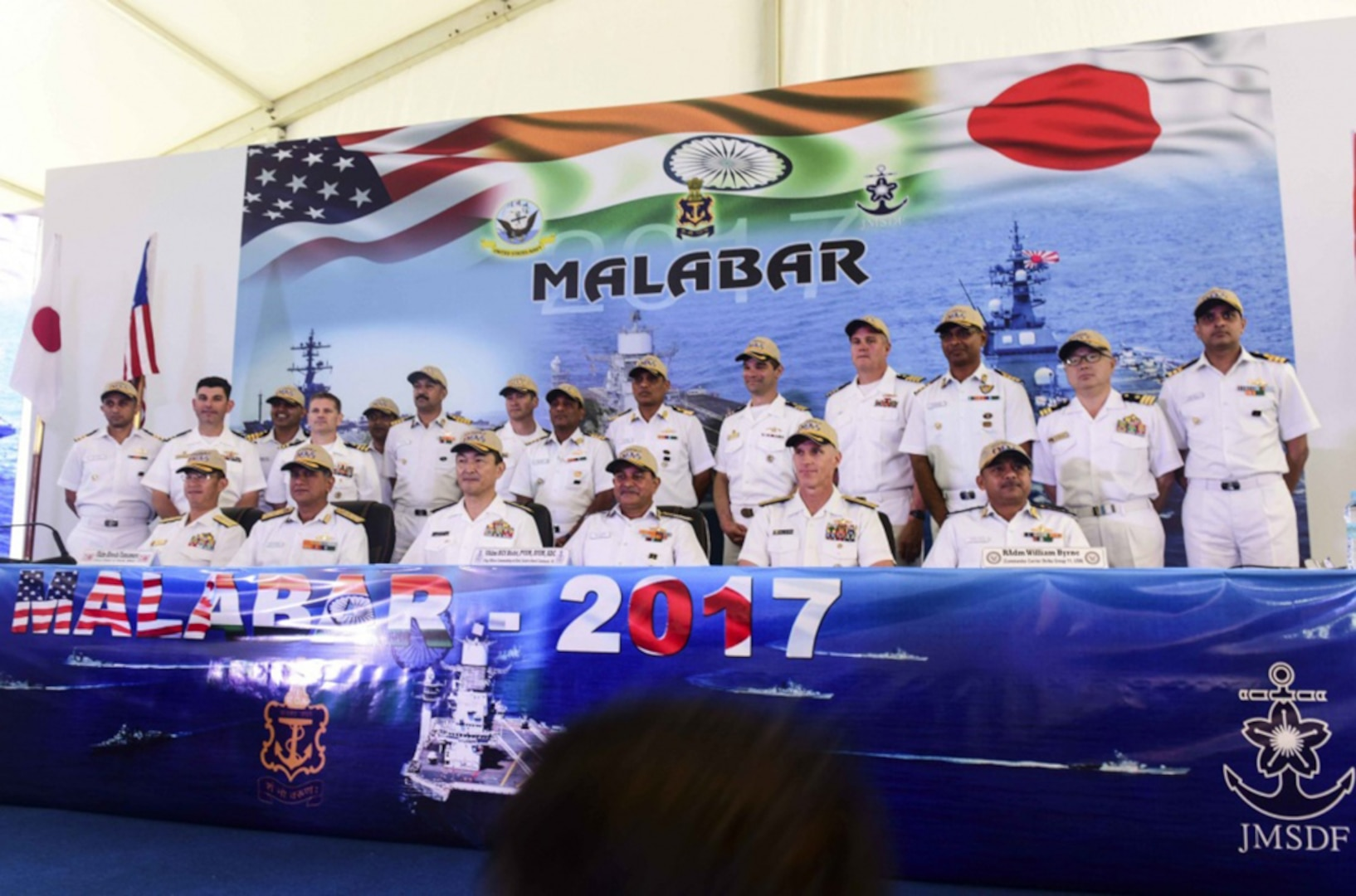 Leaders from U.S., Indian, and Japanese maritime forces pose for a photo after a press conference aboard the INS Jalashwa (LPD 41) as part of the opening ceremonies of exercise Malabar 2017. Malabar 2017 is the latest in a continuing series of exercises between the Indian Navy, Japan Maritime Self Defense Force and the U.S. Navy that has grown in scope and complexity over the years to address the variety of shared threats to maritime security in the Indo-Asia Pacific.