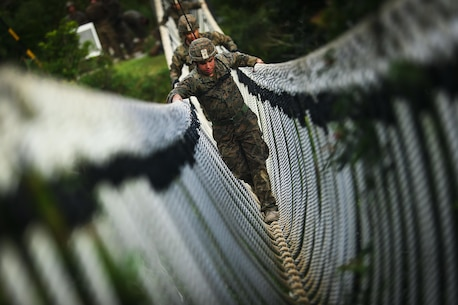 Cpl. Bryan Hernandezrodriguez, a Hialeah, Florida native and rifleman assigned to Bravo Company, 1st Battalion, 3rd Marine Regiment, travels across a rope bridge during the endurance course, aboard Camp Gonzales, Okinawa, Japan, July 7, 2017.The Jungle Warfare Training Center provides individual and unit level training to increase survivability and lethality while operating in a jungle environment. The Hawaii-based battalion is forward deployed to Okinawa, Japan as part of the Unit Deployment Program. (U.S. Marine Corps photo by Cpl. Aaron S. Patterson)