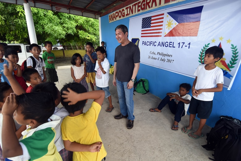 Dr. John Cinco, founder of Pacific Angel (PACANGEL), talks with the children of Anapog Integrated School during PACANGEL 2017 in San Remigio, Northern Cebu Province, Philippines, June 29, 2017. PACANGEL is a multilateral humanitarian assistance civil military engagement, which improves military-to-military partnerships in the Pacific while also providing medical health outreach, civic engineering projects and subject matter exchanges among partner forces. (U.S. Air Force photo/Master Sgt. Jeff Andrejcik)