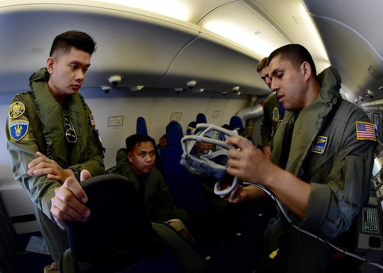 170622-N-QV906-359 CEBU, Philippines (June 22, 2017) Naval Aircrewman Operator 2nd Class Pedro Gonzalez of Combat Air Crew 4 attached to Patrol Squadron 26 (VP-26) demonstrates the emergency oxygen system aboard a P-8 Poseidon aircraft during a demonstration flight for Maritime Training Activity (MTA) Sama Sama 2017, June 22.  MTA Sama Sama is a bilateral maritime exercise between U.S. and Philippine naval forces and is designed to strengthen cooperation and interoperability between the nations' armed forces.  (U.S. Navy photo by Mass Communication Specialist 1st Class Micah Blechner/RELEASED)