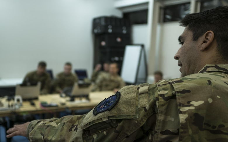 A U.S. Air Force 17th Special Operations Squadron intelligence analyst provides the intel picture of the warfighting scenario to aircrew prior to air operations July 9, 2017, at Rockhampton, Australia. Talisman Saber 2017 provides the relevant training necessary to maintain regional security, peace and stability. (U.S. Air Force photo by Capt. Jessica Tait)