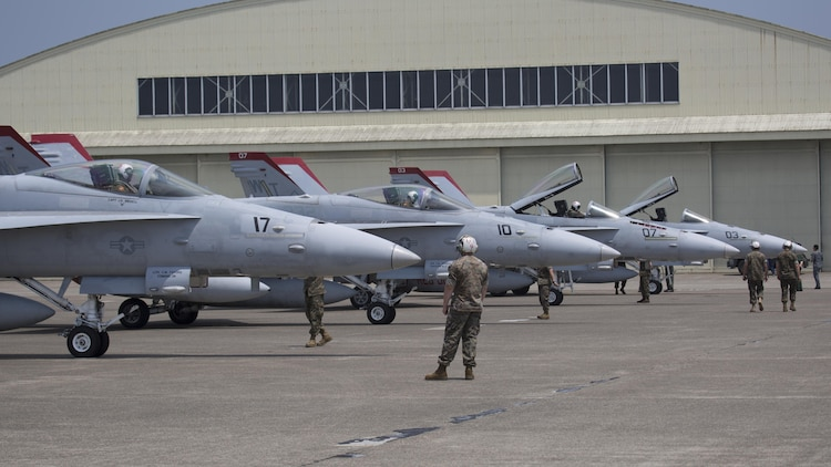 U.S. Marines with Marine Fighter Attack Squadron (VMFA) 232, taxi in F/A-18C Hornets at Japan Air Self-Defense Force (JASDF) Hyakuri Air Base, Japan, July 7, 2017. VMFA-232 is conducting exercises with the JASDF as part of the Aviation Training Relocation (ATR) Program. The ATR is designed to increase operational readiness and bilateral interoperability between U.S. and Japanese forces. (U.S. Marine Corps photo by Lance Cpl. Mason Roy)